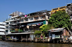Bangkok, Thailand: Homes on Chao Praya River Royalty Free Stock Image