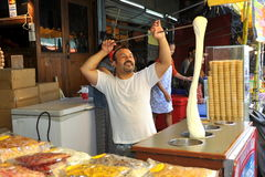 Bangkok, Thailand: Ice Cream Vendor. Vendor puts on a show as he aerates his homemade Turkish vanilla ice cream at his small stand at the renowned Chatuchak Royalty Free Stock Images