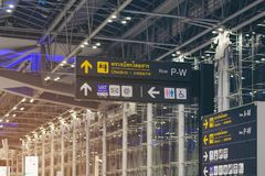 BANGKOK,THAILAND, Info sign at Suvarnabhumi International Airport. Directions for check in, boarding gates, registrations custom royalty free stock photo