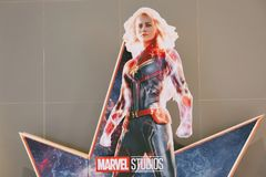 A beautiful standee of a movie called Captain Marvel or Carol Danvers stars by Brie Larson displays showing at cinema. Bangkok, Thailand - Jan 11, 2019:: A royalty free stock images