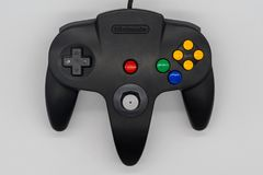 Gamecube joystick. Vintage game controller by Nintendo. Illustra Stock Images