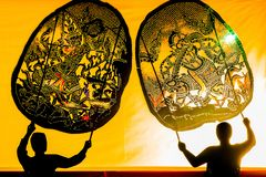 Large Shadow Play is performed at park on JAN 24, 2019. BANGKOK, THAILAND - JAN 24, 2019: Large Shadow Play is performed at park on JAN 24, 2019. A group of stock photos