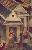 BANGKOK THAILAND - JANUARI 25, 2016: Forntida thailändsk vägg- målning av livet av Buddha på tempelväggen på Suthat Thep Wararam  arkivfoto
