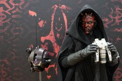 Bangkok Thailand - January 11, 2020: Action figure model Darth Maul in hood holding binoculars with droid DRK-1 from Star Wars