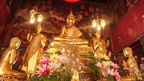 Details of golden buddha statue with tales of the lord Buddha`s Royalty Free Stock Image