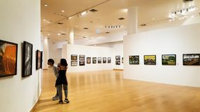 BANGKOK, THAILAND - JANUARY 11, 2018: A man and woman are seeing photography gallery in Bangkok Art & Culture Centre stock photo