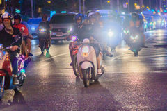 Bangkok, Thailand - January 30, 2017: Many Motorcycles on Sathor. N Road in Bangkok, nearby Chong Nonsi BTS Station, in evening time. Motorists wait at a royalty free stock photo