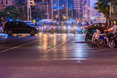 Bangkok, Thailand - January 30, 2017: Many Motorcycles on Sathor. N Road in Bangkok, nearby Chong Nonsi BTS Station, in evening time. Motorists wait at a royalty free stock photography