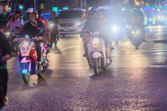 Bangkok, Thailand - January 30, 2017: Many Motorcycles on Sathor. N Road in Bangkok, nearby Chong Nonsi BTS Station, in evening time. Motorists wait at a royalty free stock images