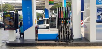 Modern gas fuel station has many types of oil for filling to car and vehicle With staff waiting to serve customers.