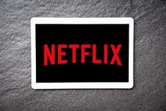 Netflix app on Tablet service watching entertainment and movies with Netflix logo stock images