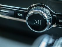 Play and pause button in Volvo car new model. BANGKOK, THAILAND - JANUARY 1 : Play and pause button with volume ring control in Volvo car new model in Bangkok royalty free stock image