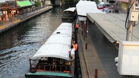 Bangkok, Thailand - January 27, 2018 : Saen Saep Khlong canal boats in asia arrive passengers through waterways of Bangkok