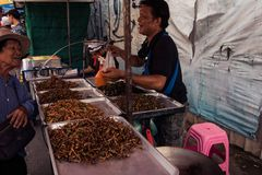 A street vendor, at Chatuchak market royalty free stock image