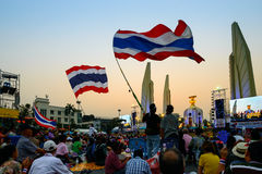 Bangkok, Thailand - January 4, 2014: Thai Anti-government protesters. Bangkok, Thailand - January 4, 2014: Anti-government protesters wave big Thai flags at the royalty free stock photography