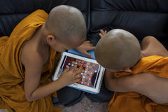 BANGKOK THAILAND - JANUARY 9 : two little buddha monk playing dr Royalty Free Stock Images