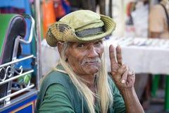 Portrait old man living in a poor district of Bangkok Klong Toe. Thailand, close up. BANGKOK, THAILAND - JANUARY 21, 2015: Unidentified man living in a poor royalty free stock photo