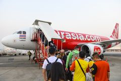 Bangkok, Thailand - January 30, 2019 : Unidentified tourists going up to the plane with Thai airasia at Don muang airport royalty free stock photo