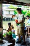 Bangkok, Thailand : Japanese tourists are feeding fish Royalty Free Stock Photography
