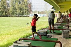 Bangkok Thailand - 27 Jul 2019 boy practicing his golf at golf driving range.