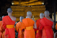 BANGKOK, THAILAND -11 JUL 2014 thai monks stand in the hall for stock photography