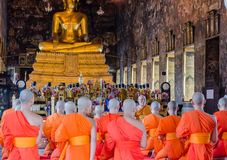 BANGKOK, THAILAND -11 JUL 2014 thai monks stand in the hall for royalty free stock image