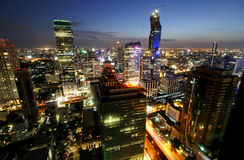 BANGKOK, THAILAND - JULY 1, 2015 : Business district with high building at dusk Royalty Free Stock Images
