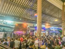 Bangkok, Thailand - July 7, 2017: Crowds of people waiting for b. Uses at Mochit bus station during long weekend to go back to their provincial home royalty free stock images