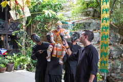 Bangkok, THAILAND - July 14, 2017: Puppet of Hanuman in Ramakien. Or Ramayana Story with Puppeteer wear the black mask in klong bang luang floating market in Royalty Free Stock Image