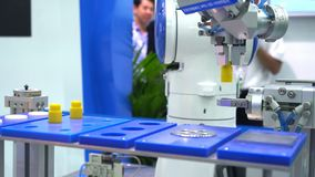 Robot hand machine gripping simulated object. Use smart robot in Propack asia industry event. Robotic tool in factory. Robot stock video footage