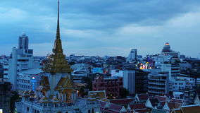 BANGKOK, THAILAND - JULY 23, 2017 : Time-lapse day to night Bangkok cityscape Local buildings and Wat Traimit at twilight evening. Tint effect stock video footage