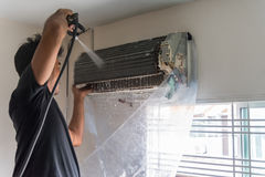Cleaning air conditioner by water for clean a dust Stock Image