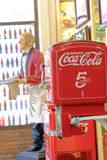BANGKOK, THAILAND - July 1, 2017: Vintage machine of coin operated Coca Cola bottle vending machine.  stock photos