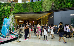 Inside of shopping mall in Bangkok, Thailand. Bangkok, Thailand - Jun 17, 2017. People walking at Siam Paragon Shopping Mall in Bangkok, Thailand. Bangkok Royalty Free Stock Photo