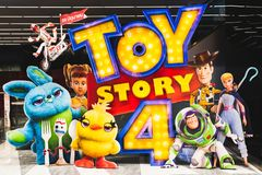 Bangkok, Thailand - Jun 17, 2019: Toy Story 4 movie backdrop display with cartoon characters in movie theatre. Cinema promotional advertisement, or film royalty free stock photos