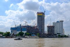 BANGKOK, THAILAND-2 JUN 2017, View of modern building construction hotel and giant cranes on the quays in the dockland area near royalty free stock images