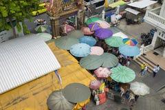 Bangkok, Thailand - June 28, 2015: Aerial view of gate entrance of Wat Trimitr Vityaram Voravihahn Temple of the Golden Buddha. Ma. Ny multi-color umbrellas stock photos