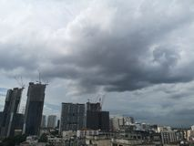 Bangkok, Thailand-June 10,2019; Black rain clouds floating in the sky environment house and building city stock photo