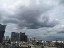 Bangkok, Thailand-June 10,2019; Black rain clouds floating in the sky environment house and building city stock photos