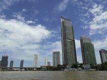 BANGKOK, THAILAND - June 13, 2017: Boats and buildings on the Ch. Ao Phraya River in the blue sky in Bangkok, Thailand Royalty Free Stock Photo