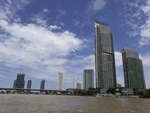 BANGKOK, THAILAND - June 13, 2017: Boats and buildings on the Ch. Ao Phraya River in the blue sky in Bangkok, Thailand Royalty Free Stock Photos