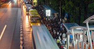 BANGKOK, THAILAND - JUNE 9: Busy bus station in the Mo Chit area of Bangkok after the Chatuchak market has closed many. People come to this stop to wait for a stock video footage