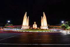Democracy Monument with blur lighting of car traffic in night time. Bangkok , Thailand - 15 June, 2019 : Democracy Monument with blur lighting of car traffic in royalty free stock images