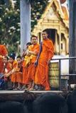 BANGKOK, THAILAND - JUNE 27, 2015: Novice Buddhist monks stand w Royalty Free Stock Photo