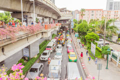 Bangkok, Thailand - June 5, 2016 : Side view of sky train road at station and a lot of traffic under. Bangkok, Thailand - June 5, 2016 : Side view of sky train royalty free stock image