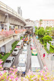 Bangkok, Thailand - June 5, 2016 : Side view of sky train road at station and a lot of traffic under. Bangkok, Thailand - June 5, 2016 : Side view of sky train royalty free stock photo