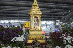 Bangkok, Thailand - June 28, 2015: Small golden shrine at Suvarnabhumi International Airport. Concept of Buddhism, the major relig. Ion in Thailand royalty free stock photo