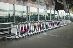 Bangkok, Thailand - June 28, 2015: Stacked empty trolleys in Suvarnabhumi Airport Royalty Free Stock Photo
