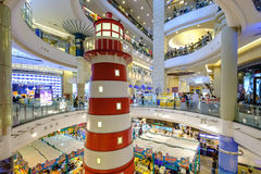 Terminal 21 shopping mall top view with many people inside. Bangkok, Thailand - June 2, 2017: Terminal 21 shopping mall top view with many people inside Stock Photos