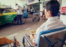BANGKOK, THAILAND - JUNE 21: An unidentified elderly waits for t stock photos